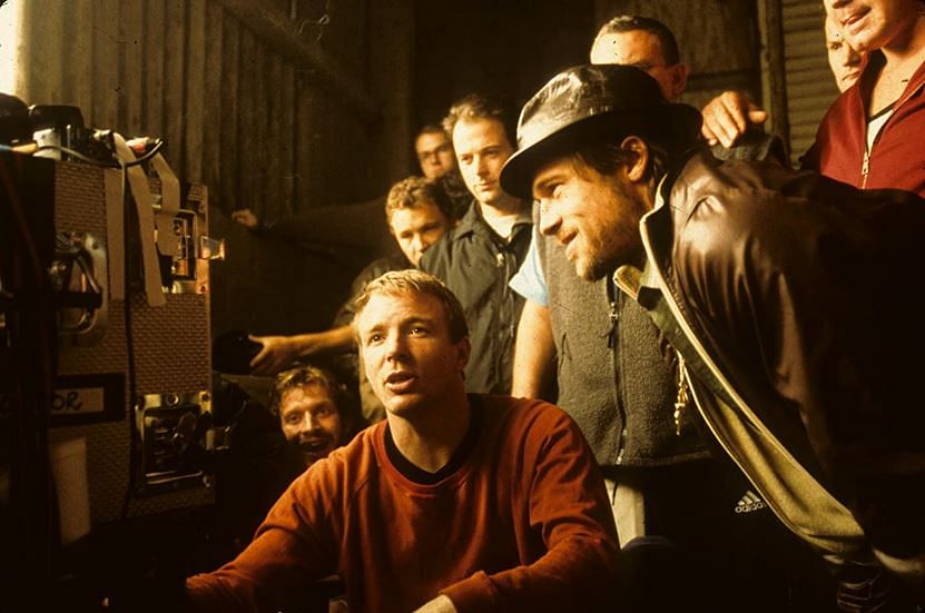 "<div class=""paragraphs""><p>Guy Ritchie, Brad Pitt on the sets of 'Snatch' (2000)</p></div>"