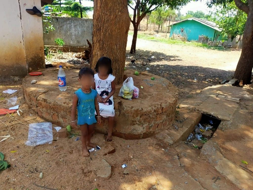 The two kids who lost their parents overnight cry, as fear of COVID stopped other villagers from reaching out to them.