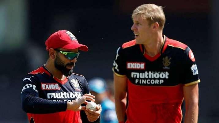Virat Kohli and Kyle Jamieson during IPL 2021