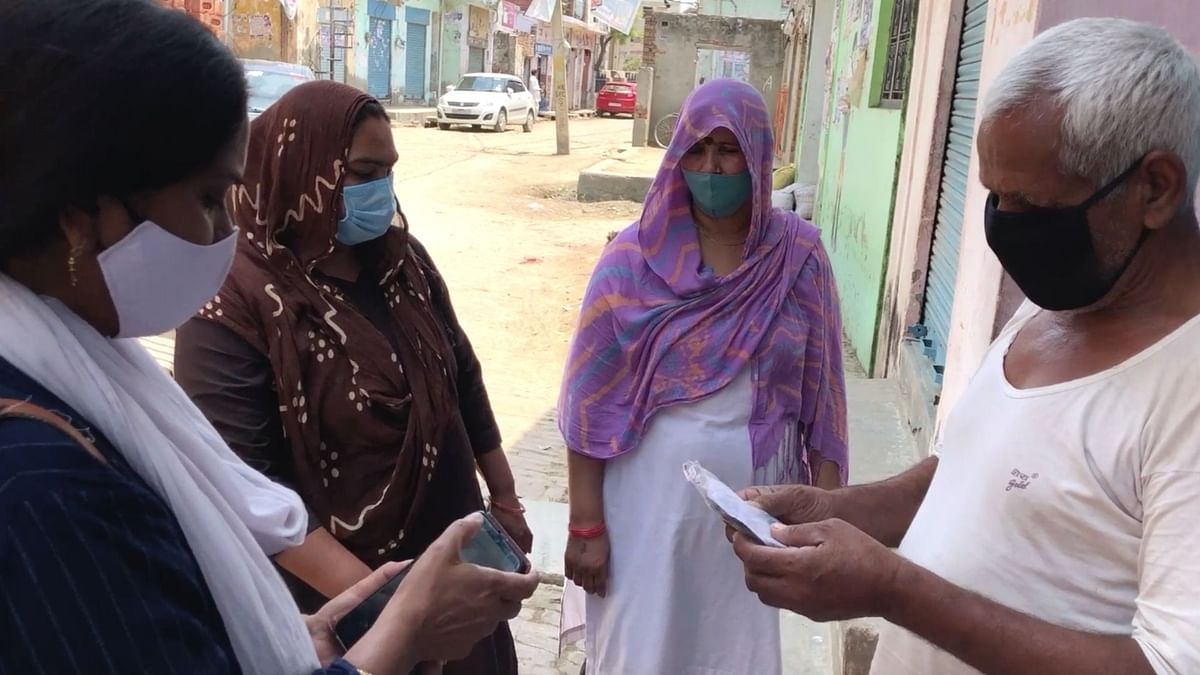 ASHA workers go door-to-door to distribute medicines.