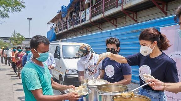Jacqueline Distributes Meals as Part of a COVID Relief Initiative