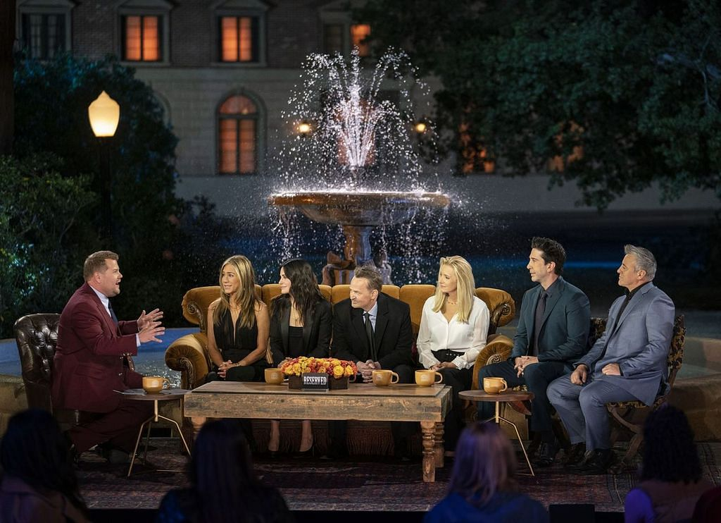 The cast of <i>Friends</i> in front of the iconic fountain, with James Corden.