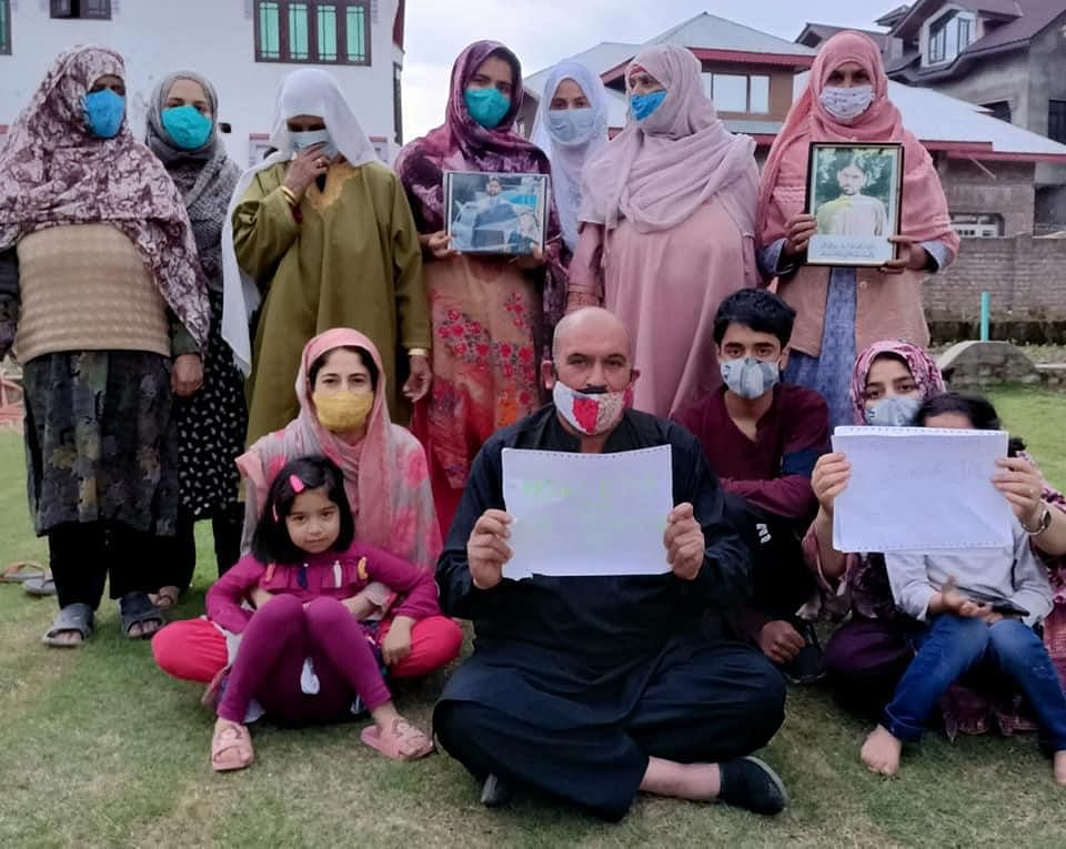 Human rights activist Mohammad Ahsan Untoo, who spent almost a year in jail, stages a protest in Srinagar with the relatives of jailed prisoners of Kashmir.