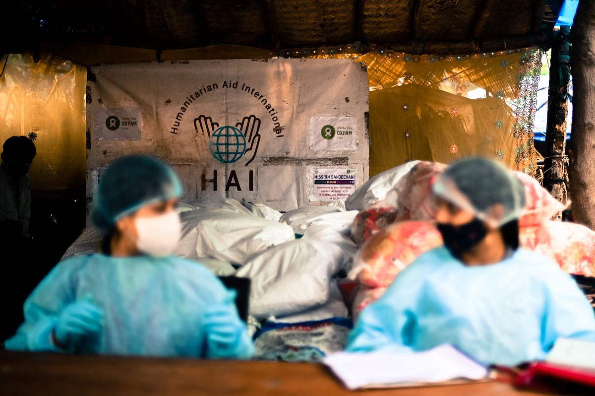 Aid workers from HAI work at a distribution facility in the Signature bridge refugee settlement in North Delhi.