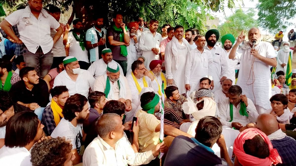 BKU spokesperson Rakesh Tikait and others stage a protest against Centre's three farm laws, at Tohana in Haryana's Fatehabad district on Sunday, June 6.