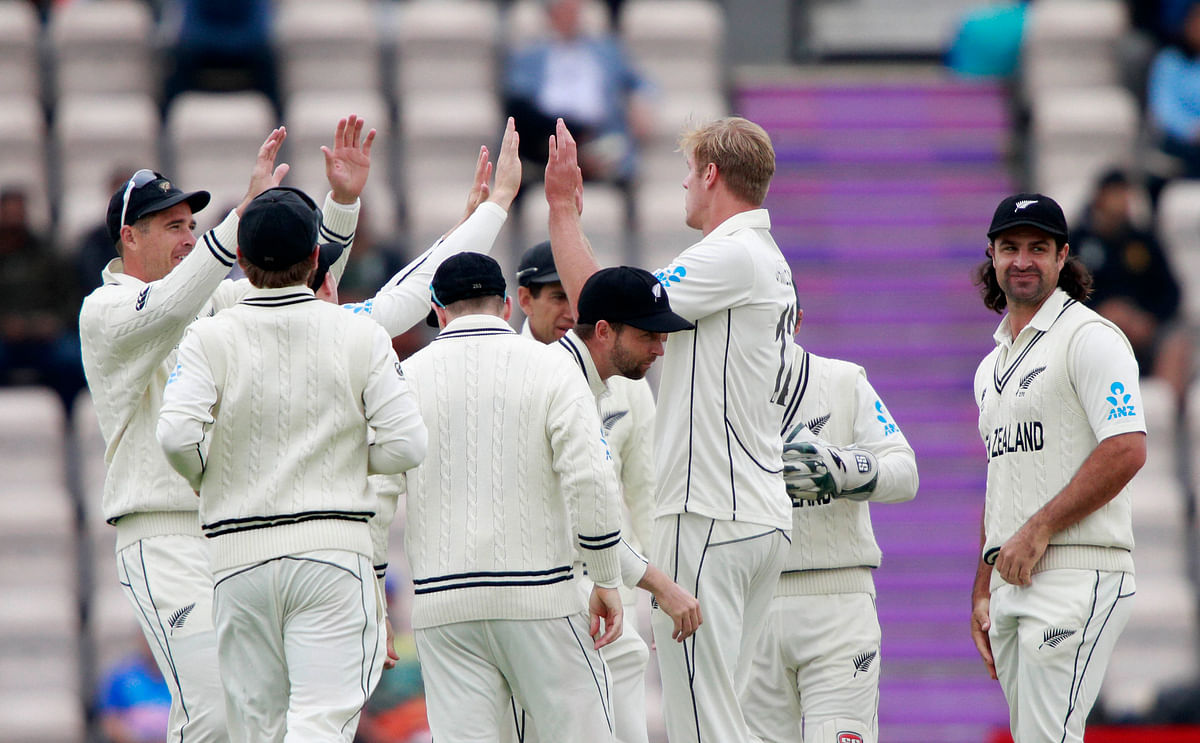 New Zealand's Kyle Jamieson, second right, celebrates with teammates the dismissal of India's captain Virat Kohli during the third day of the World Test Championship final.