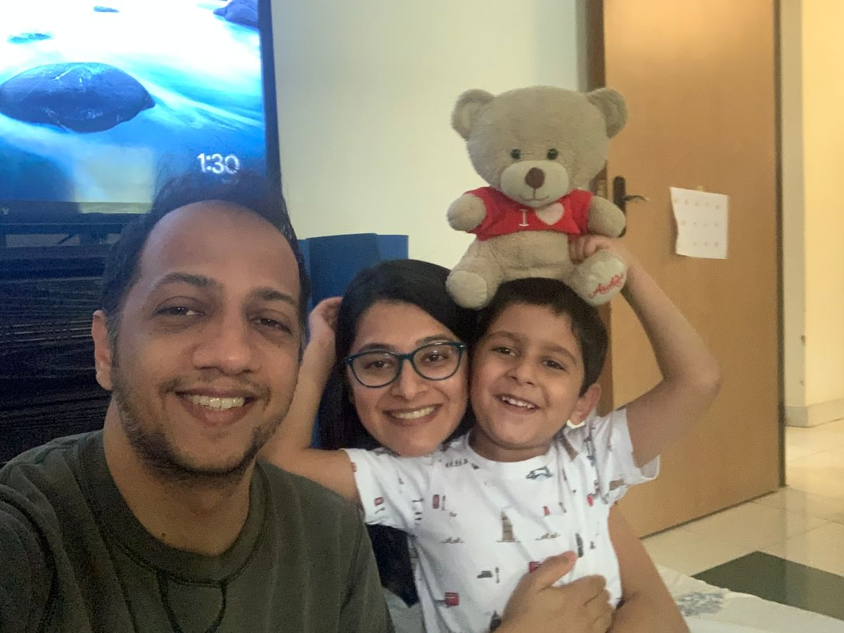 """""""Say 'Corona'!"""" This photo was taken on a lark on 24 April just before Sulabh's (bad) CT scan results came in. Sulabh is running a 102-103 temperature. Rehaan, Teddy and I developed fevers overnight so we are now all together."""