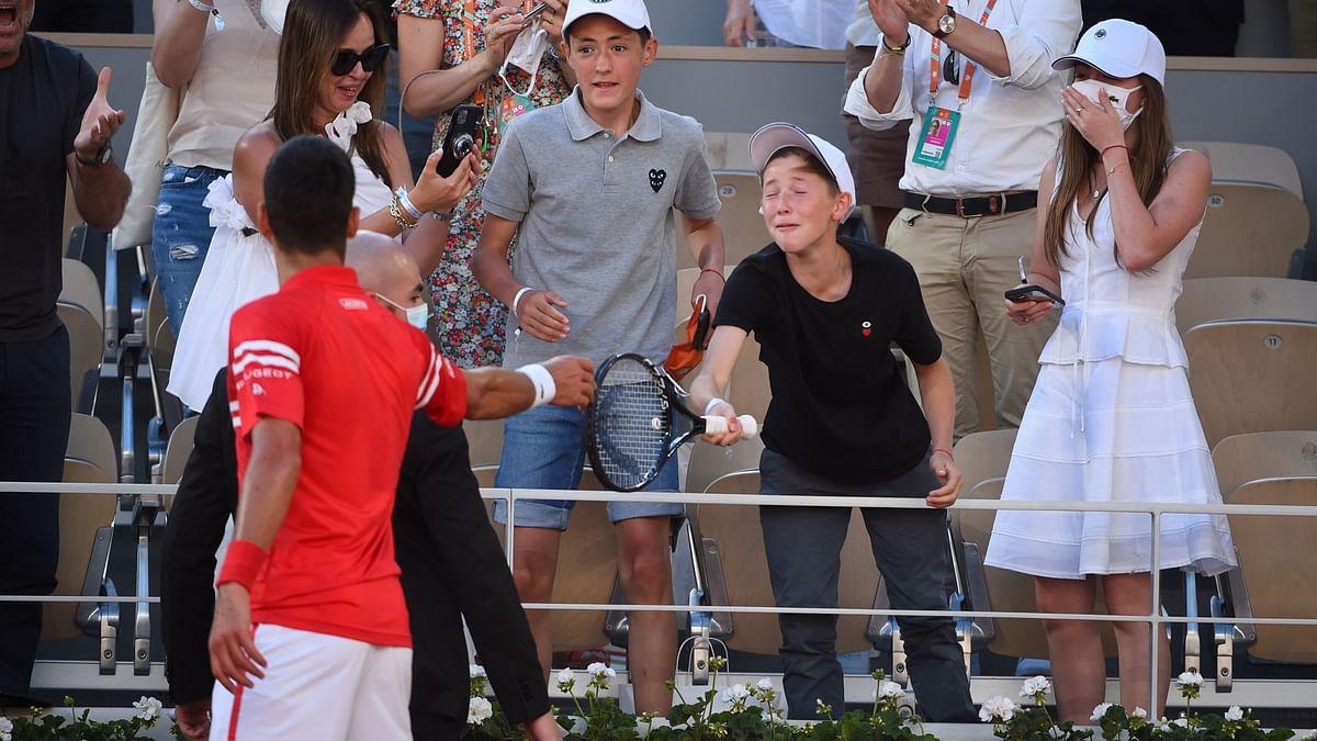 Watch: Djokovic Gifts French Open Winning Racket to Young Fan