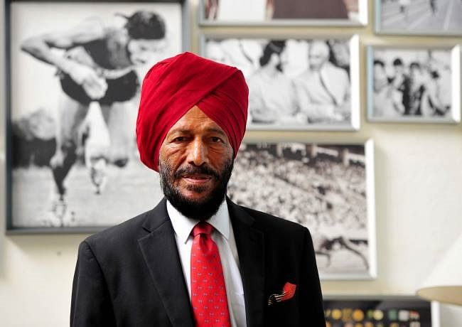 Veteran Milkha Singh posing with his long litany of accolades in the background.