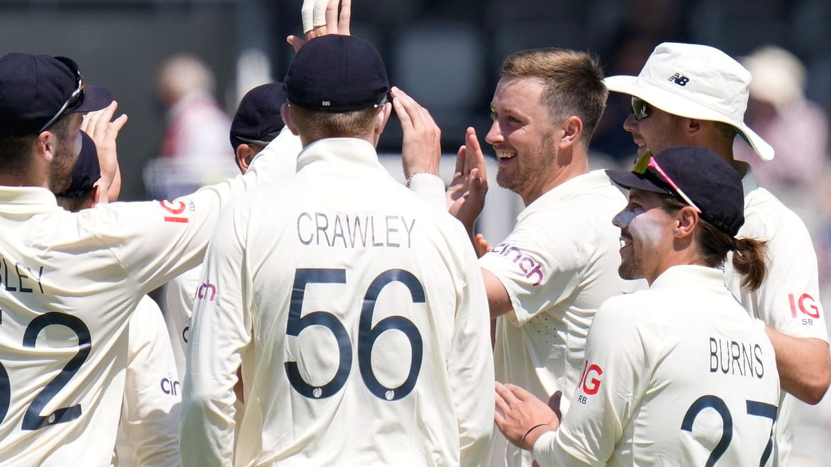 Ollie Robinson celebrates the wicket of New Zealand's Colin de Grandhomme during a Test match between England and New Zealand at Lord's cricket ground in London, Thursday, June 3, 2021.