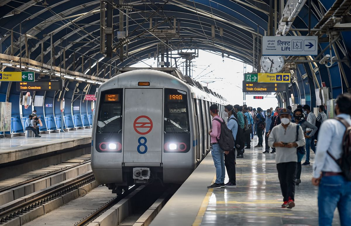 Commuters wait to board a train at the Lakshmi Nagar Metro Station after resumption of the Delhi Metro services in a graded manner, in New Delhi.