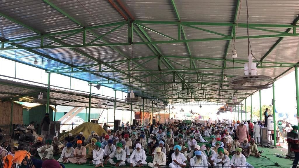 """<div class=""""paragraphs""""><p>The farmers protesting against the government's three agricultural ordinances, held an event to commemorate Kranti Diwas at Delhi's Singhu Border on Wednesday, 30 June.</p><p><br></p></div>"""