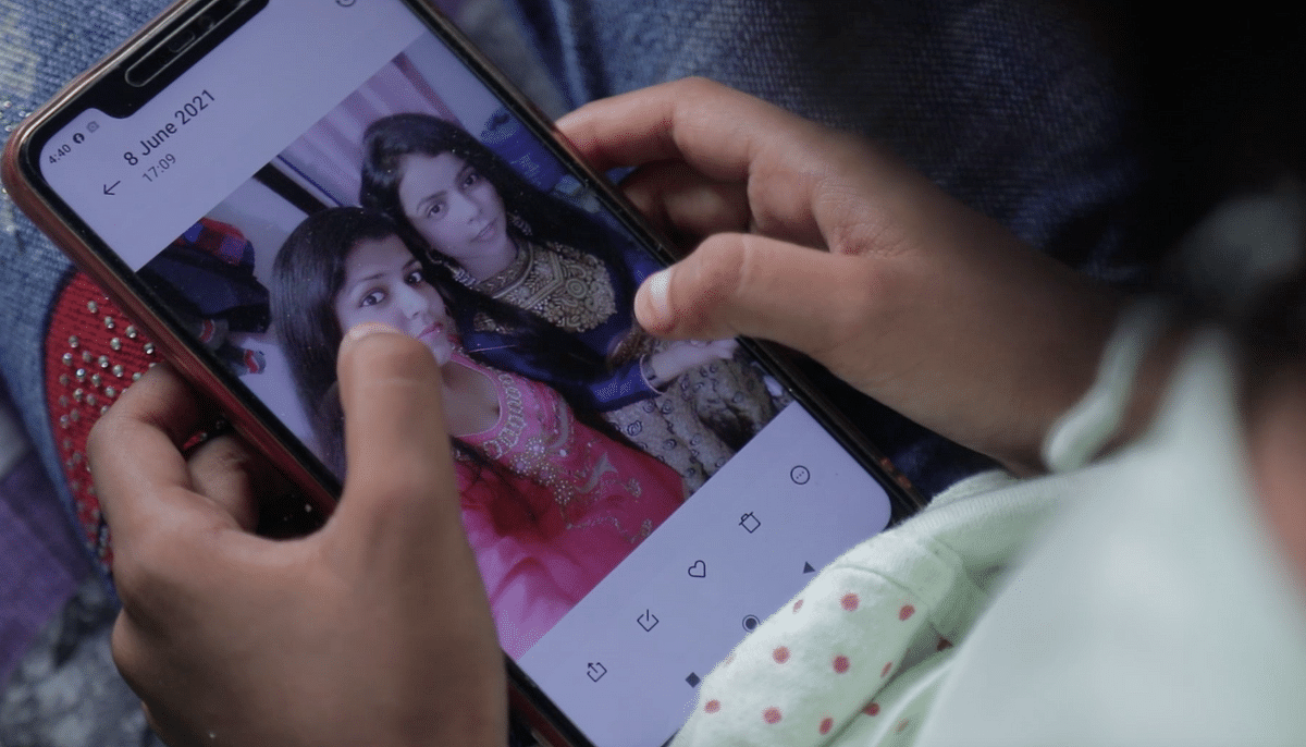 """<div class=""""paragraphs""""><p>Naziya looking at her mother's photo on her phone.&nbsp;</p></div>"""