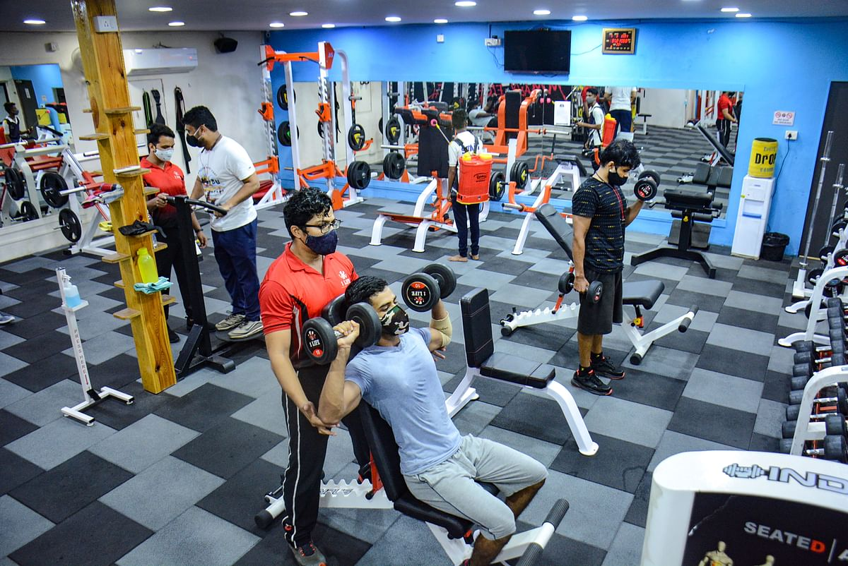 Thane: People workout at a gym that opened after unlocking process of Covid-19 lockdown began in a phased manner, in Thane