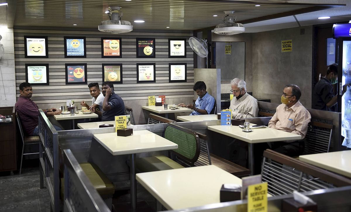 People visit a restaurant that was reopened after unlocking of COVID-19 lockdown began in a phased manner, at Bandra in Mumbai.