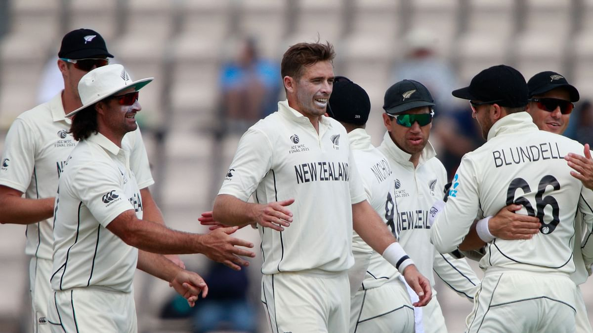 New Zealand's Tim Southee, centre without cap, celebrates with teammates the dismissal of India's Jasprit Bumrah during the sixth day of the World Test Championship final cricket match between New Zealand and India.