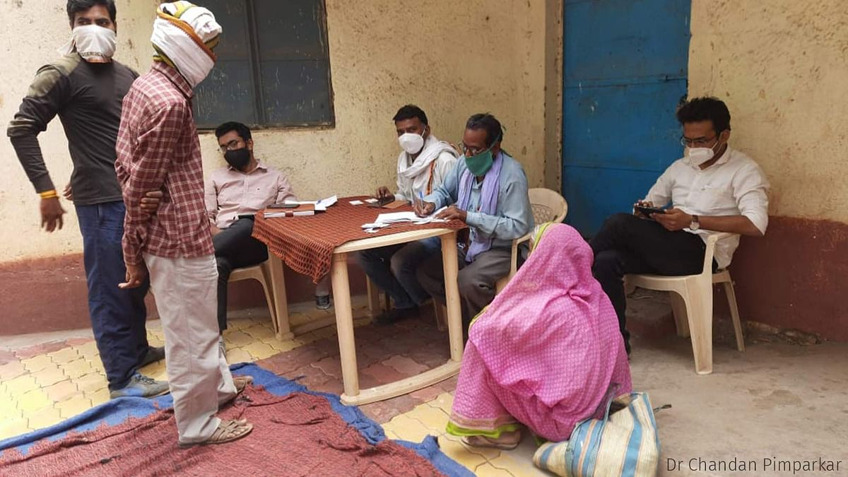 Registration of vaccine beneficiaries in Chinchkheda. A PHC doctor registered the eligible citizens using his cellphone.