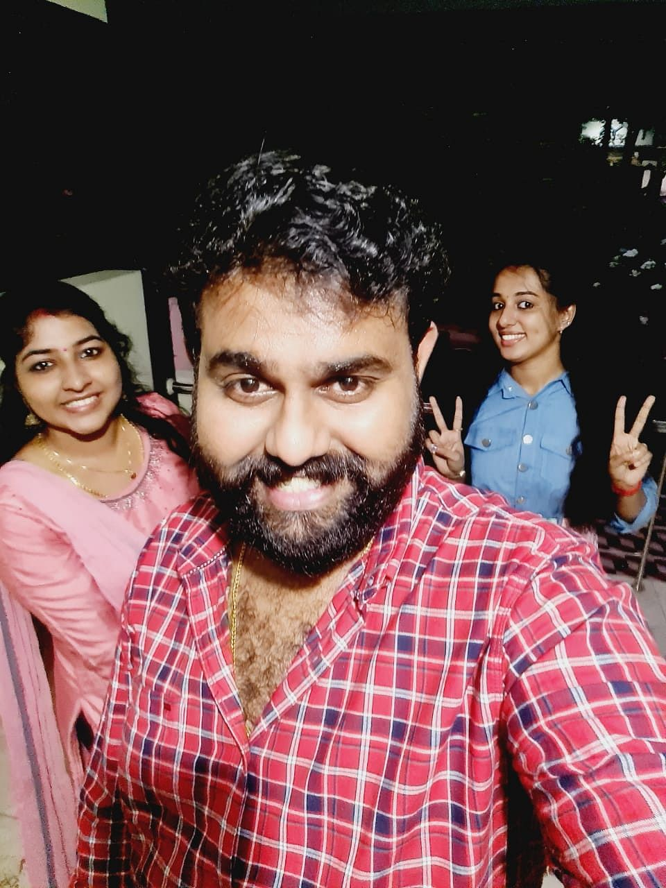 Vismaya (right) with her brother Vijith V Nair and sister-in-law Revathi.