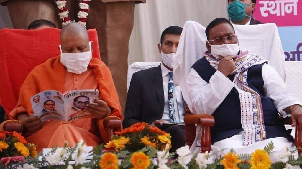 "<div class=""paragraphs""><p>UP CM Yogi Adityanath with UP Labour Minister Swami Prasad Maurya</p></div>"