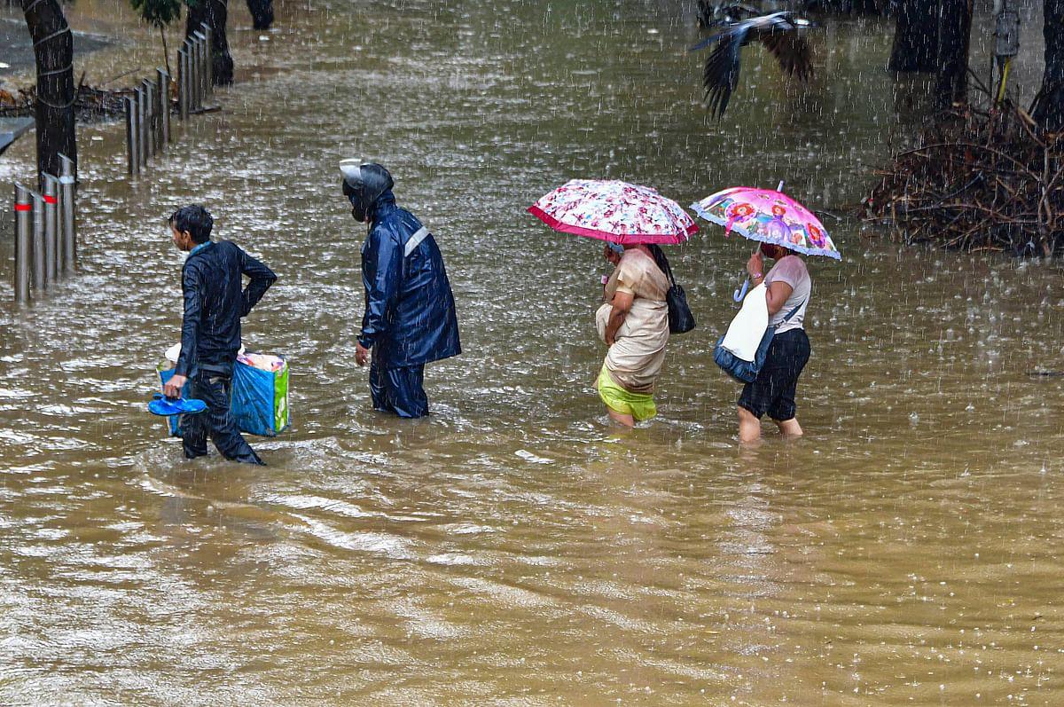 In Photos | Mumbai Rains: Roads Waterlogged and Rail Services Hit