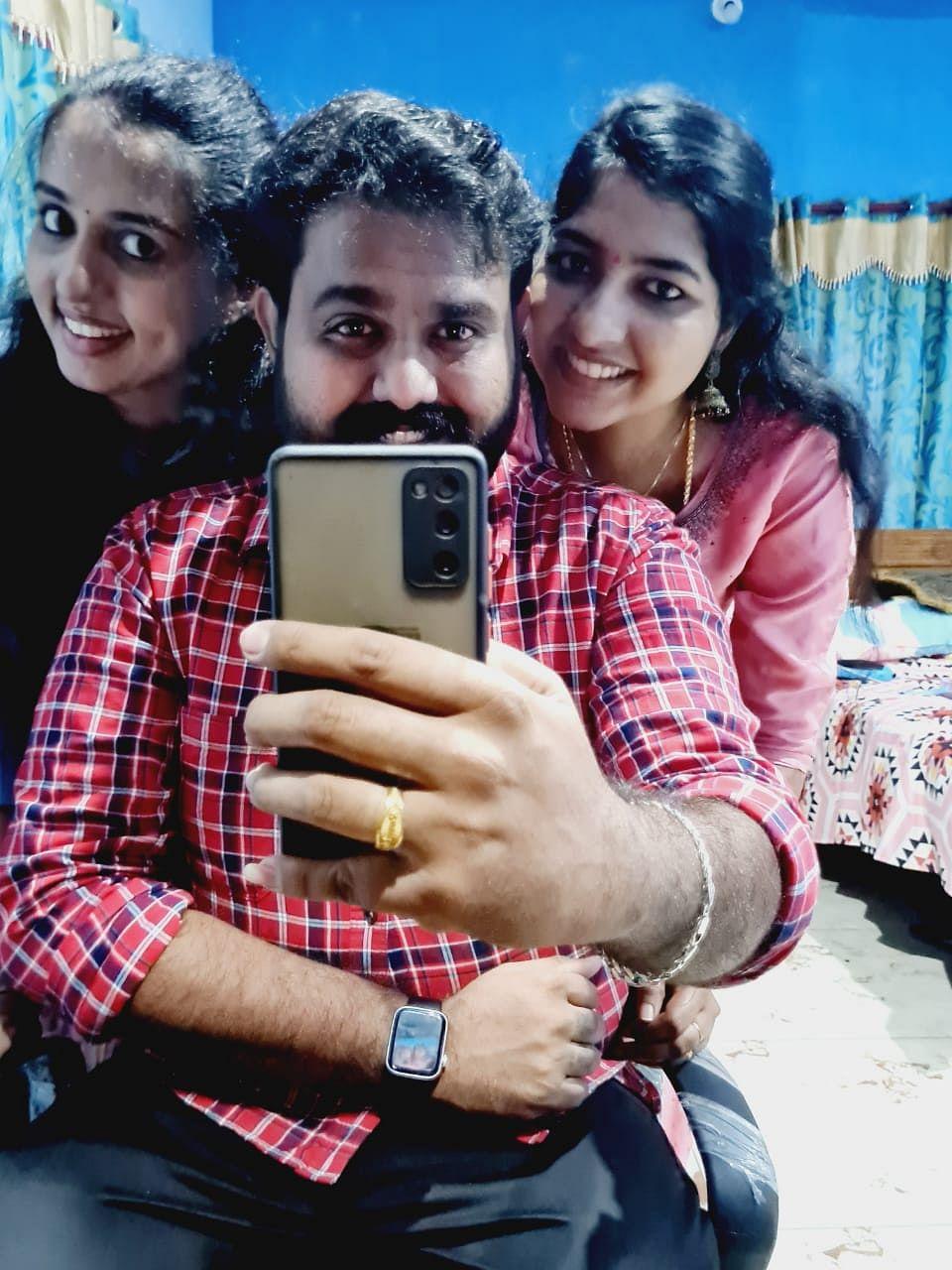Vismaya V Nair (left) with her brother Vijith V Nair and sister-in-law Revathi.