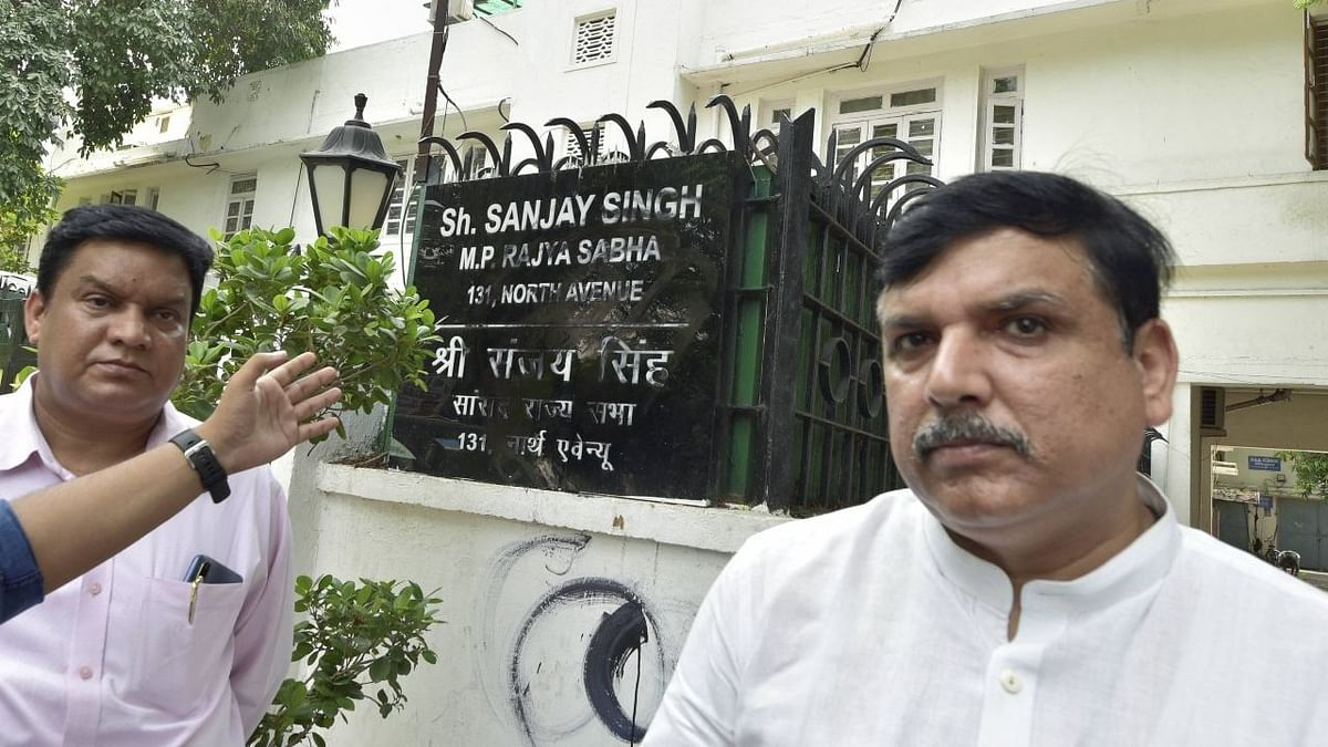 AAP MP Sanjay Singh outside his residence in New Delhi, as the police said an attempt was made to deface his nameplate.