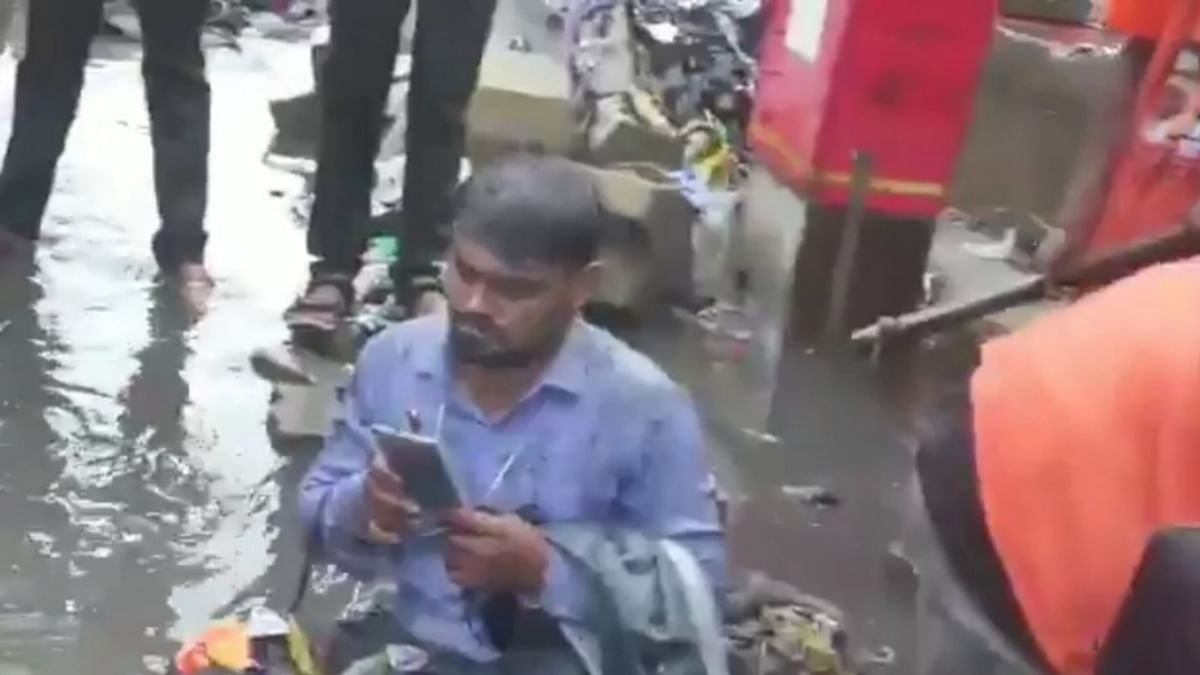 Shiv Sena MLA Dilip Lande on Saturday, forced a BMC contractor to sit on a waterlogged road in Mumbai and asked people to dump garbage on him for not getting drains cleaned properly.
