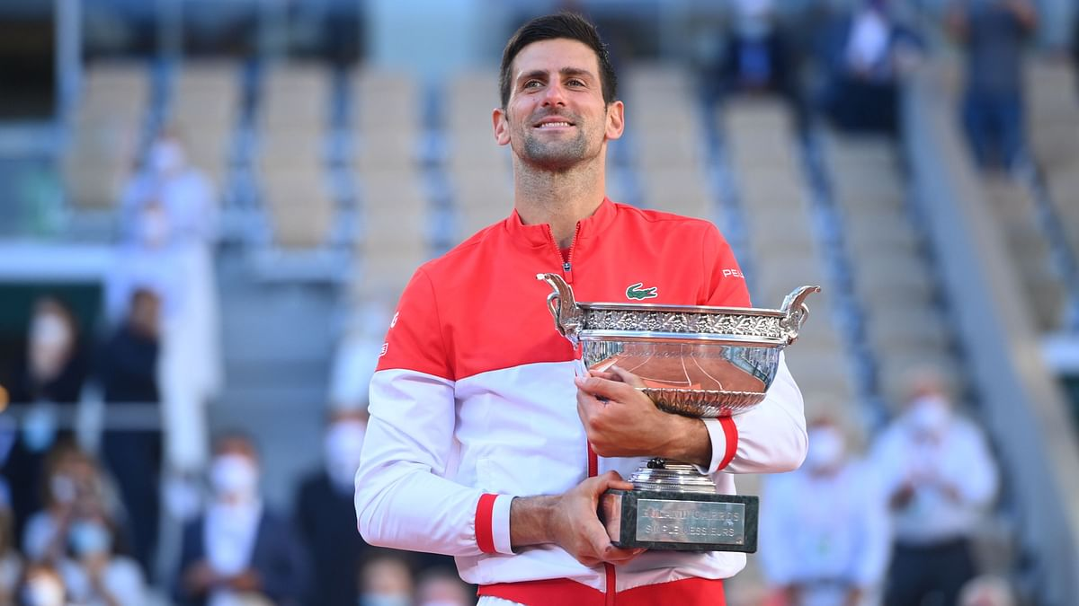 Novak Djokovic with the French Open trophy. It is his 19th Grand Slam title.