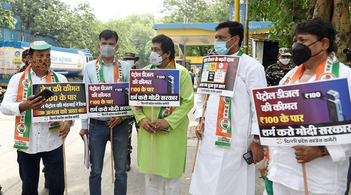 All India Congress Committee and Delhi Congress protest against frequent hikes in the prices of petrol and diesel at Tajman Singh Road Petrol Pump in New Delhi.