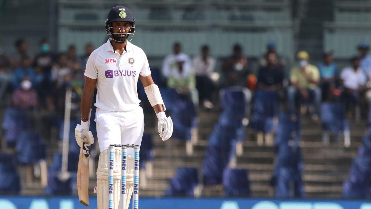 Cheteshwar Pujara walks back after being dismissed.