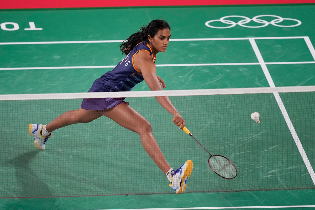 """<div class=""""paragraphs""""><p>Tokyo:  India's Pusarla V. Sindhu competes against Israel's Ksenia Polikarpova during their women's singles badminton match at the 2020 Summer Olympics, Sunday, July 25, 2021, in Tokyo, Japan. </p></div>"""