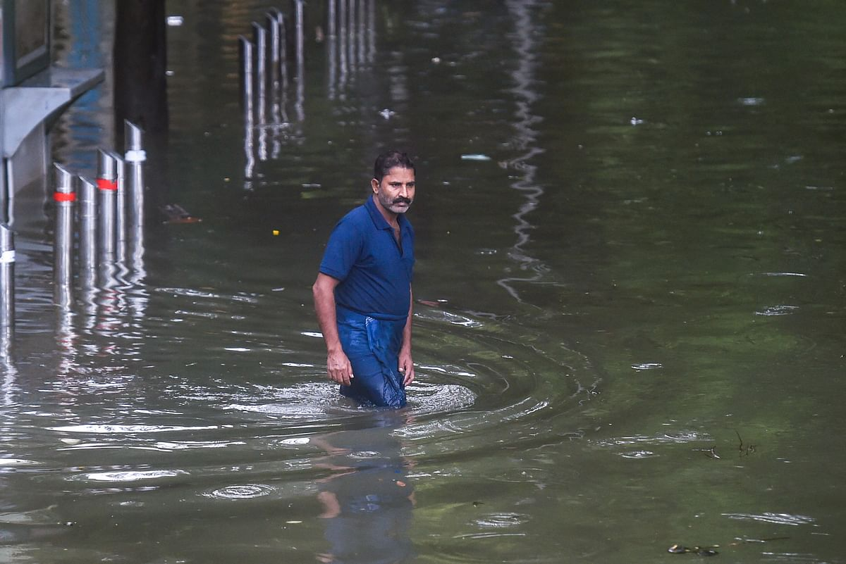 "<div class=""paragraphs""><p>A man wades through a waterlogged street at Parel after heavy rains in Mumbai, 18 July.</p></div>"