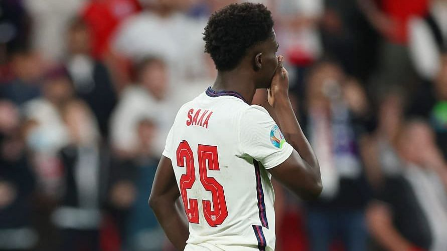 """<div class=""""paragraphs""""><p>Bukayo Saka reacts after missing his penalty against Italy in the Euro 2020 final.&nbsp;</p></div>"""
