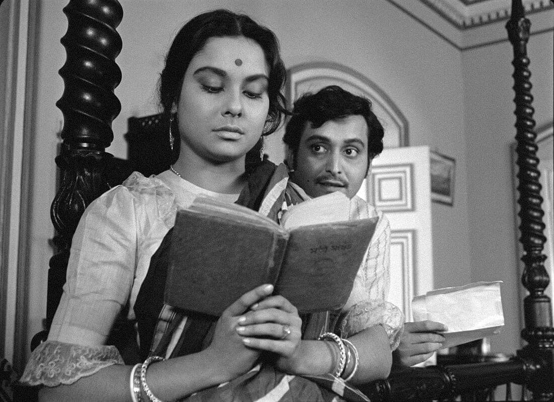 """<div class=""""paragraphs""""><p>Soumitra Chatterjee and Madhabi Mukherjee in Charulata.</p></div>"""