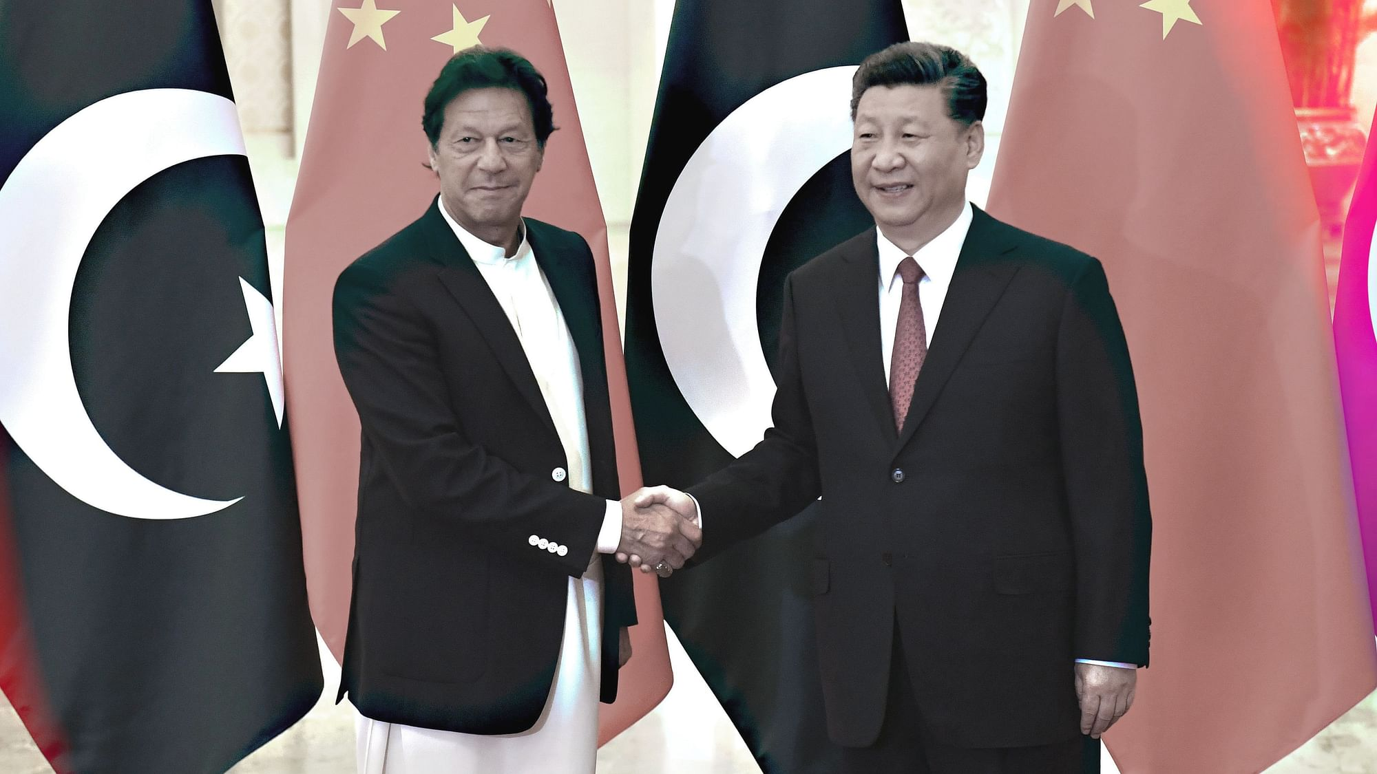 """<div class=""""paragraphs""""><p>China's President Xi Jinping, right, shakes hands with Pakistan's Prime Minister Imran Khan </p></div>"""