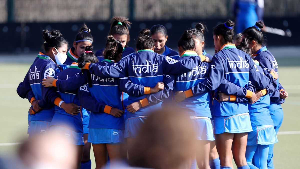 """<div class=""""paragraphs""""><p>Indian Women's hockey team in a huddle before their match at 2020 Tokyo Olympics</p></div>"""