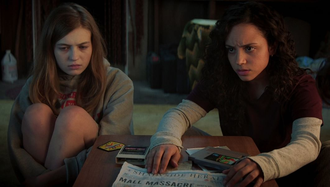 """<div class=""""paragraphs""""><p>Olivia Welch and Kiana Madeira in a still from <em>Fear Street Part 1: 1994</em>.</p></div>"""