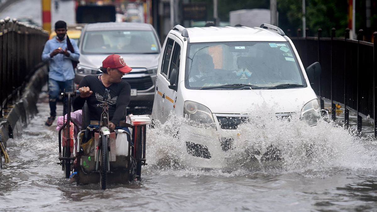 "<div class=""paragraphs""><p>Mumbai: Commuters wade through a waterlogged street at Kings Circle, in Mumbai<br></p></div><div class=""paragraphs""><p><br></p></div>"