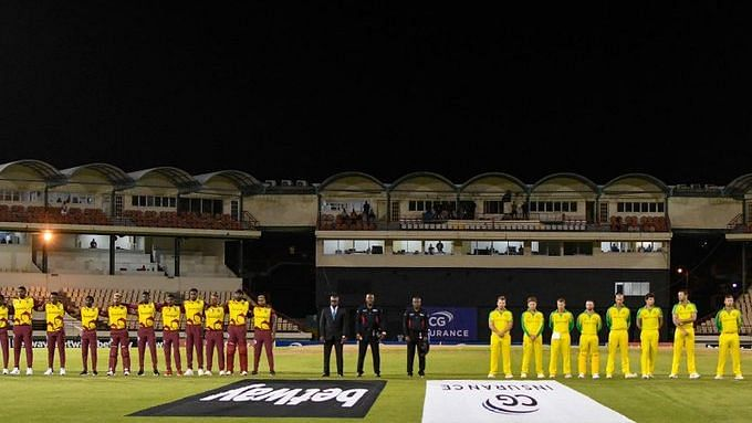 """<div class=""""paragraphs""""><p>West Indies and Australia players line up for the national anthem.</p></div>"""