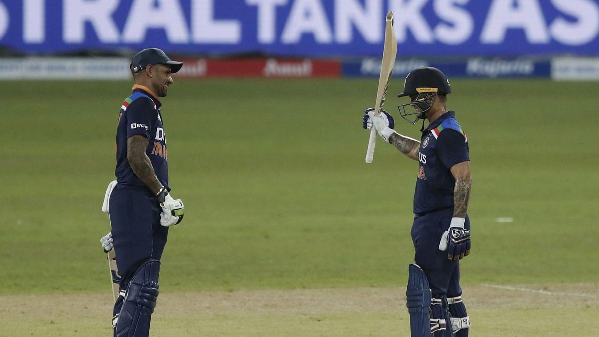 "<div class=""paragraphs""><p>Captain Shikhar Dhawan smiles on as Ishan Kishan celebrates his half century, on ODI debut.</p></div>"