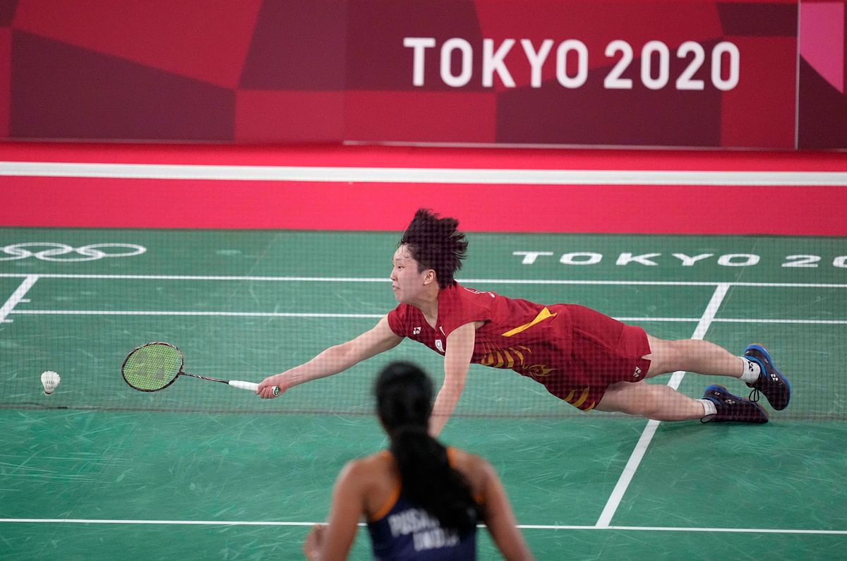 """<div class=""""paragraphs""""><p> Japan's Akane Yamaguchi plays against India's Pusarla V. Sindhu during their women's singles badminton quarterfinal match at the 2020 Summer Olympics, Friday, July 30, 2021, in Tokyo, Japan.</p></div>"""