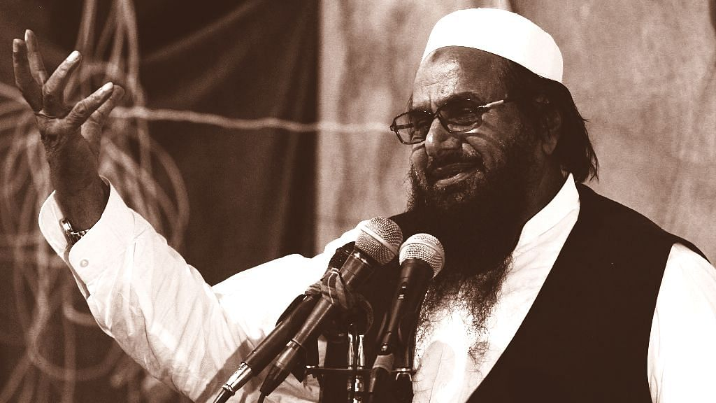 """<div class=""""paragraphs""""><p>Election in Pakistan occupied Kashmir sees banned terrorist organisations' participation. Photo of Hafiz  Saeed, Chief of  Jamaat-ud-Dawah is used for representative purposes.&nbsp;</p></div>"""