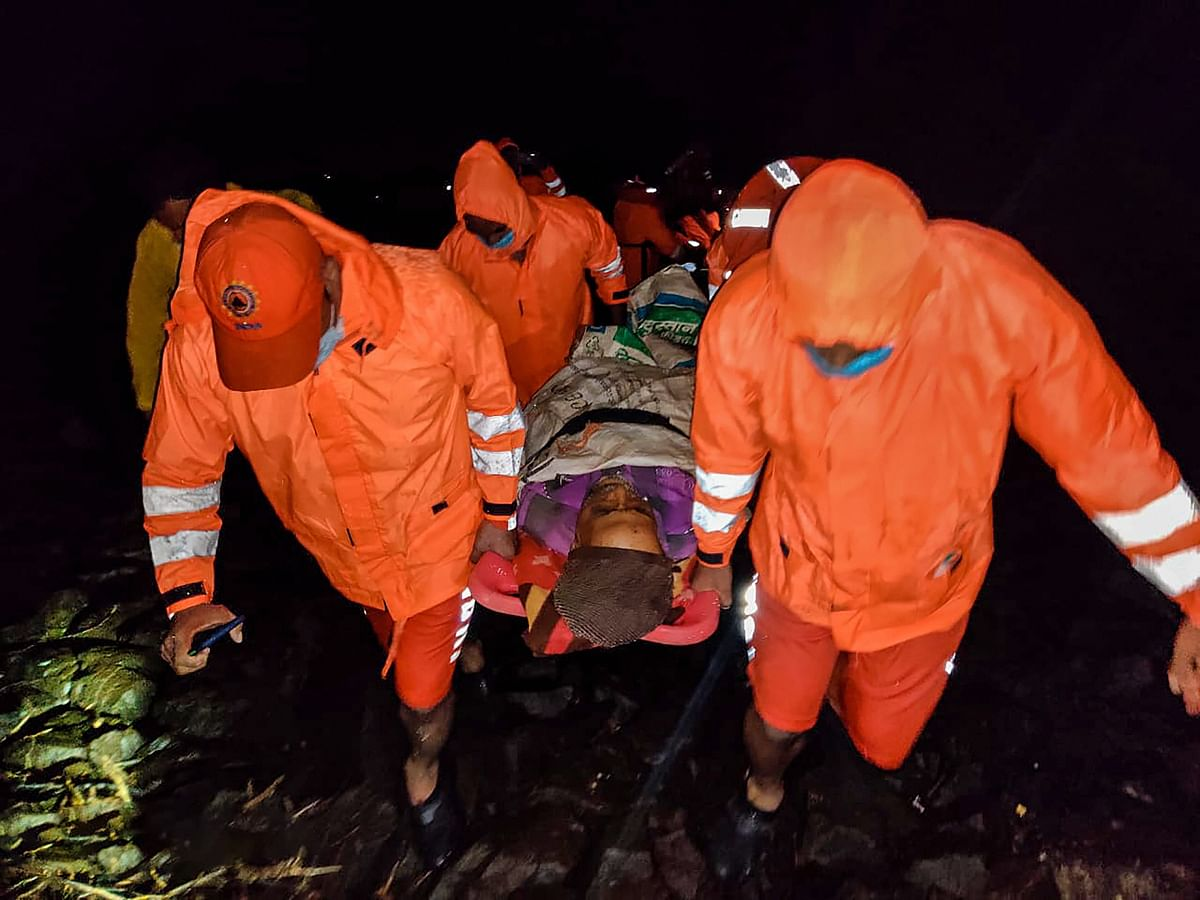 """<div class=""""paragraphs""""><p>NDRF team evacuates a 60 years old man having multiple fractures, during a rescue operation at a flooded area after rain at Jaoli in Satara district, Sunday, 26 July.</p></div>"""