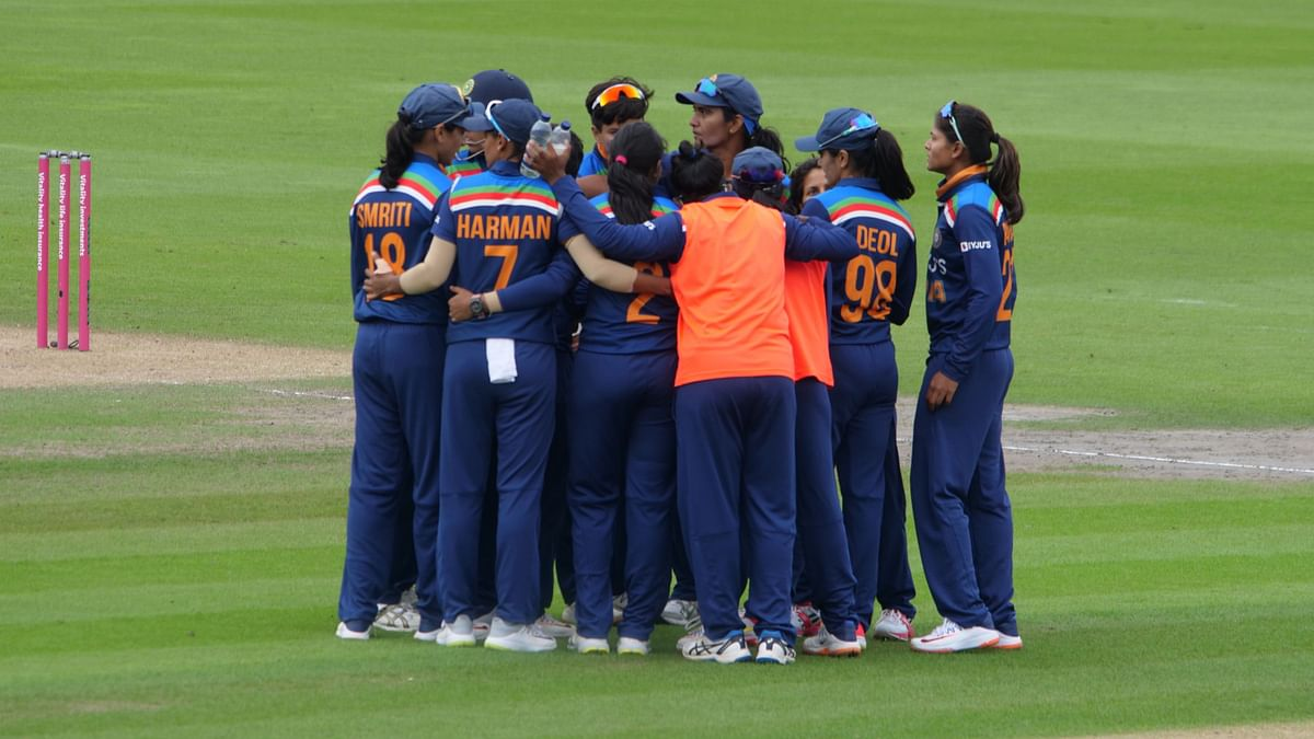 """<div class=""""paragraphs""""><p>The Indian women's team in a huddle during their game against England</p></div>"""