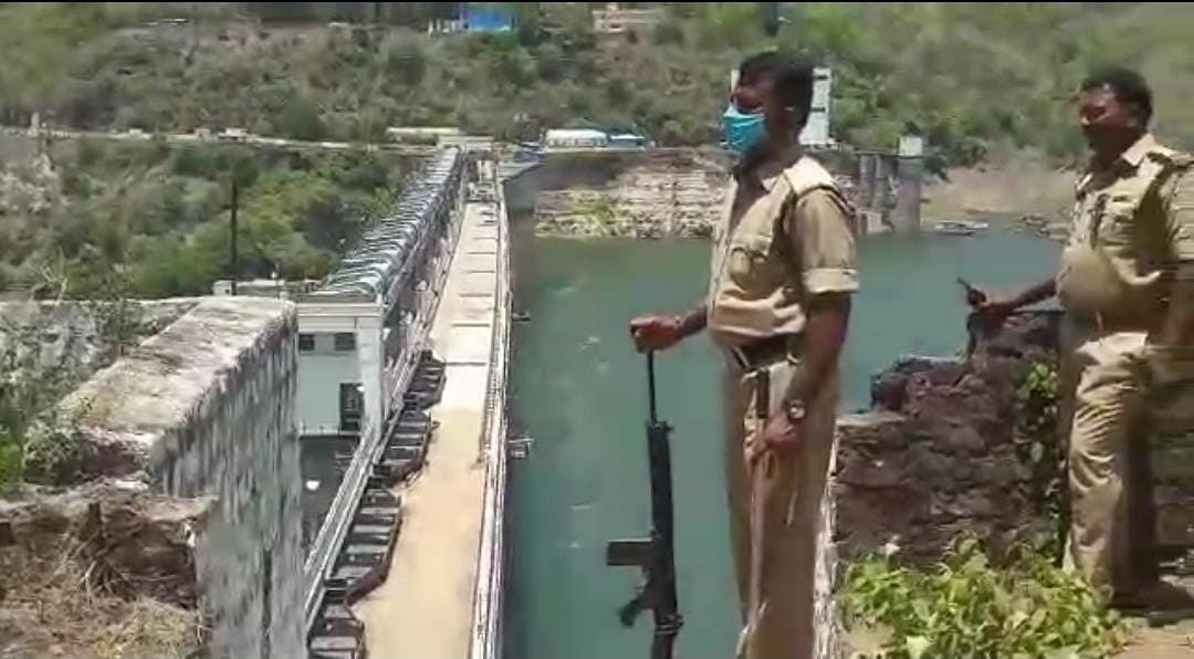 """<div class=""""paragraphs""""><p>Police personnel of Telangana stand guard near a&nbsp; hydel power project  on Krishna river.&nbsp;</p></div>"""