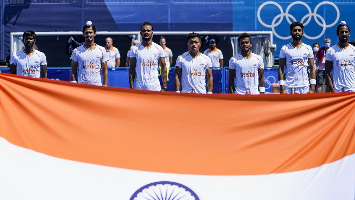 """<div class=""""paragraphs""""><p>Indian men's hockey team during the national anthem.</p></div>"""