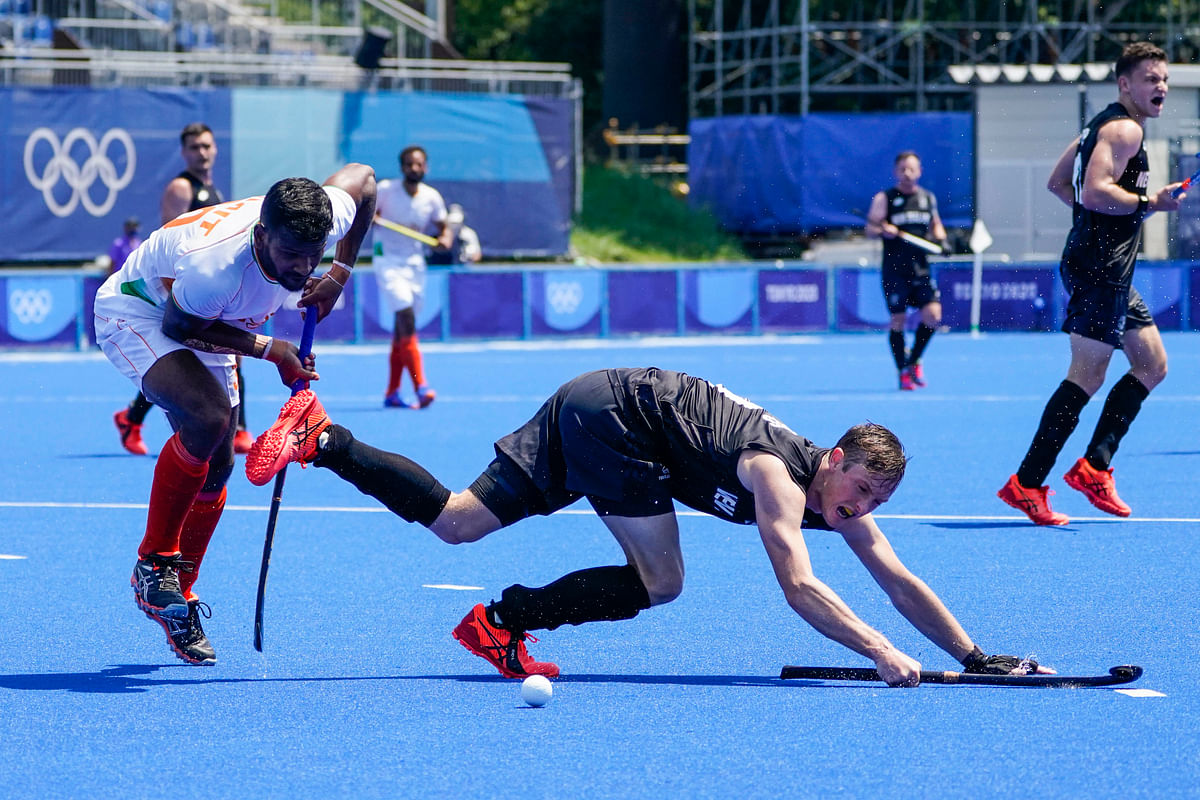 """<div class=""""paragraphs""""><p>New Zealand's Hugo Inglis, right, collides with Indias Amit Rohidas (30) during a mens field hockey match at the 2020 Summer Olympics, Saturday, July 24, 2021, in Tokyo, Japan.<br></p></div>"""