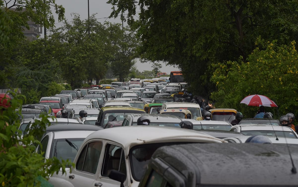 """<div class=""""paragraphs""""><p>Traffic jam near ITO due to waterlogging following heavy rains, in New Delhi on Monday.</p></div>"""