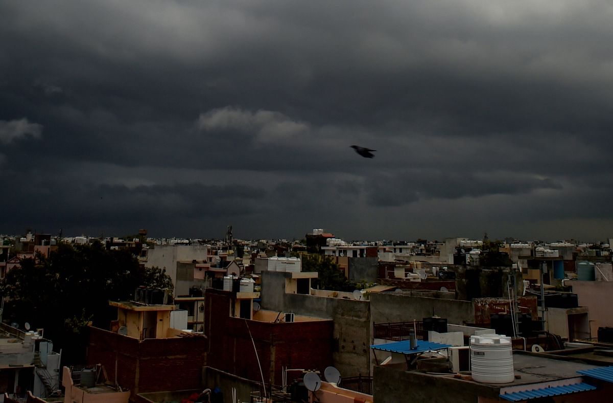 """<div class=""""paragraphs""""><p>Monsoon clouds hover in the sky in New Delhi on Tuesday.</p></div>"""
