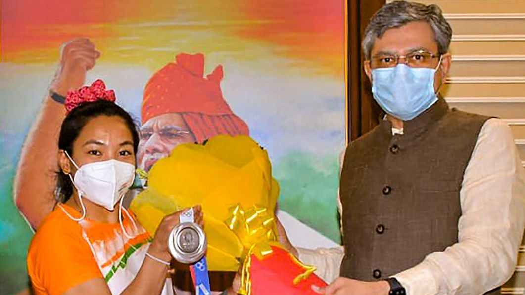 """<div class=""""paragraphs""""><p>Mirabai received an award of Rs 2cr and a promotion from Railways minister.</p></div>"""